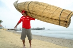 Santos Urcia with his new Totora Boat. Credit: ISA/ Michael Tweddle