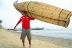 Santos Urcia with his new Totora Boat. Credit: ISA/ Michael Tweddle