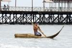 Juninho Urcia riding a Caballito de Totora Boat. Credit: ISA/ Michael Tweddle